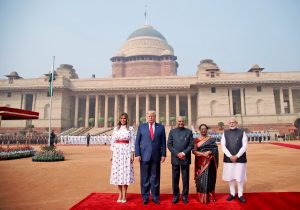 Modi-Trump pose for a group photo during a ceremonial reception at Rashtrapati Bhavan