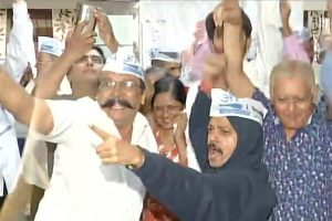 Aam Aadmi Party workers celebrate as trends indicate lead for the party