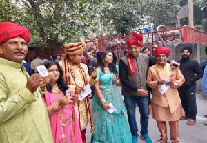 Groom, his family dressed up in wedding attire cast vote in Delhi