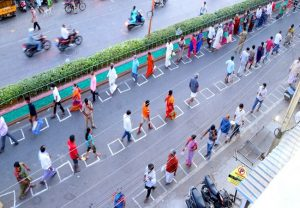 People seen maintaining social distance to buy essential goods