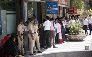 Yes Bank Crisis: Account holders stand in a queue to withdraw money | See Pics