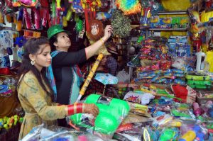 People buying colors powder and other items for Holi   See Pics