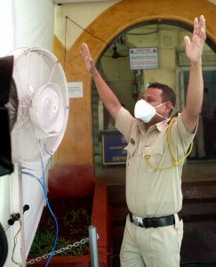 Police personnel sanitize themselves infront of mist spray fans | See Pics
