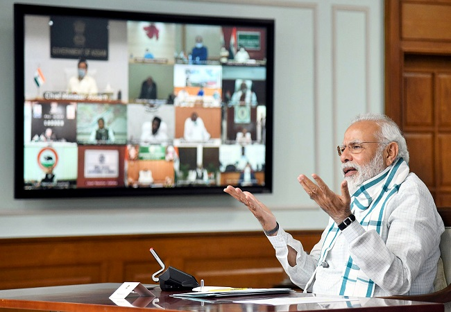 COVID-19 impact will remain visible in coming months, need to fight it with impetus on economy: Modi