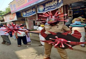 IN PICs: Cop wears 'Corona helmet' to spread awareness on Coronavirus