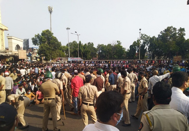 Amid lockdown, thousands of migrant workers gather at Bandra station hoping to get back home