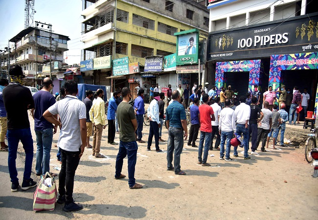 Social distancing norms flouted as liquor stores reopen