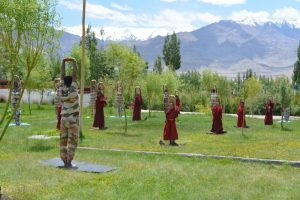 ITBP personnel and Buddhist monks practice yoga at Thiksay monastery in Leh