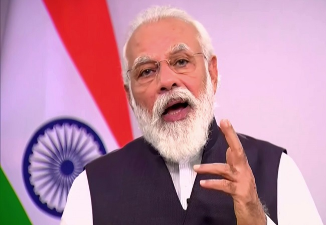 PM Narendra Modi links global and Indian revival, invites world companies to India