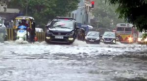 Maharashtra: Vehicles wade through water lodge street following heavy rainfall | See Pics