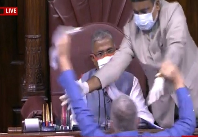 Ruckus in Rajya Sabha as opposition members rush to well & try to tear up farm bills