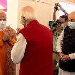 Prime Minister Narendra Modi greets senior BJP leader Lal Krishna Advani at the latter's residence on his birthday