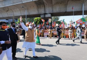 Amit Shah reaches Chennai, walks on road to greet supporters