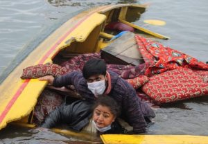 Srinagar: Boat carrying BJP activists capsizes in Dal Lake during poll rally in Dal Lake