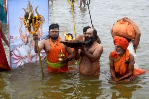 India celebrates Makar Sankranti with fervour, devotees take holy dip in Ganga; See Pics