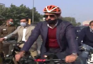 Robert Vadra rides bicycle from Khan Market to his office in protest against the rising fuel prices