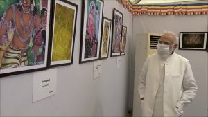 PM Modi walk through the exhibition of paintings; See Pics
