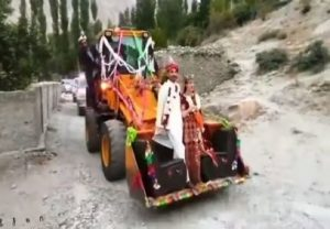 Viral Video: Pakistani Couple takes an excavator-ride to arrive in village, Netizens are amused